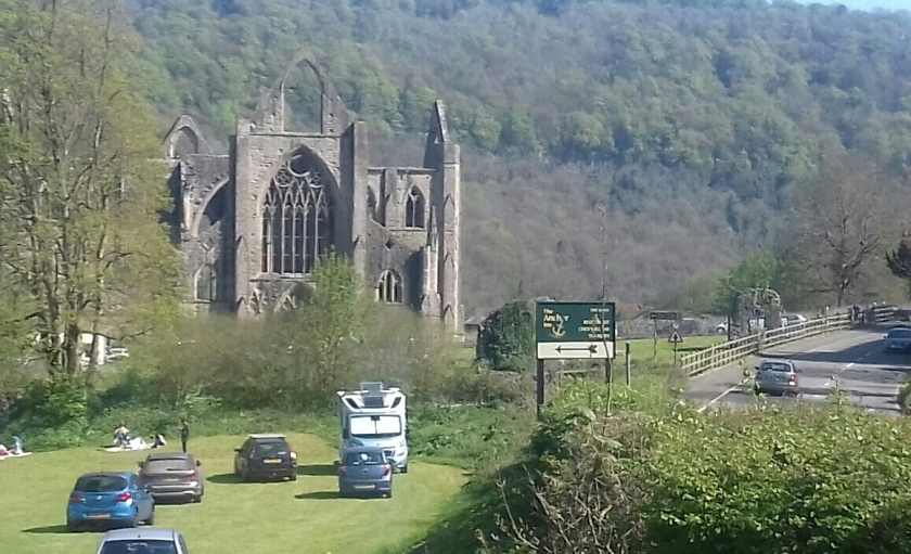 The ruins of Tintern Abbey sit in the middle of woodlands.