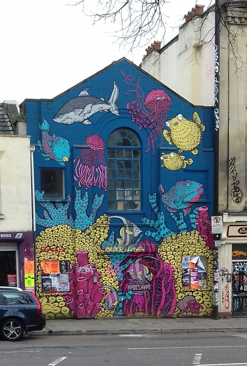 The front of this building is covered in fish.