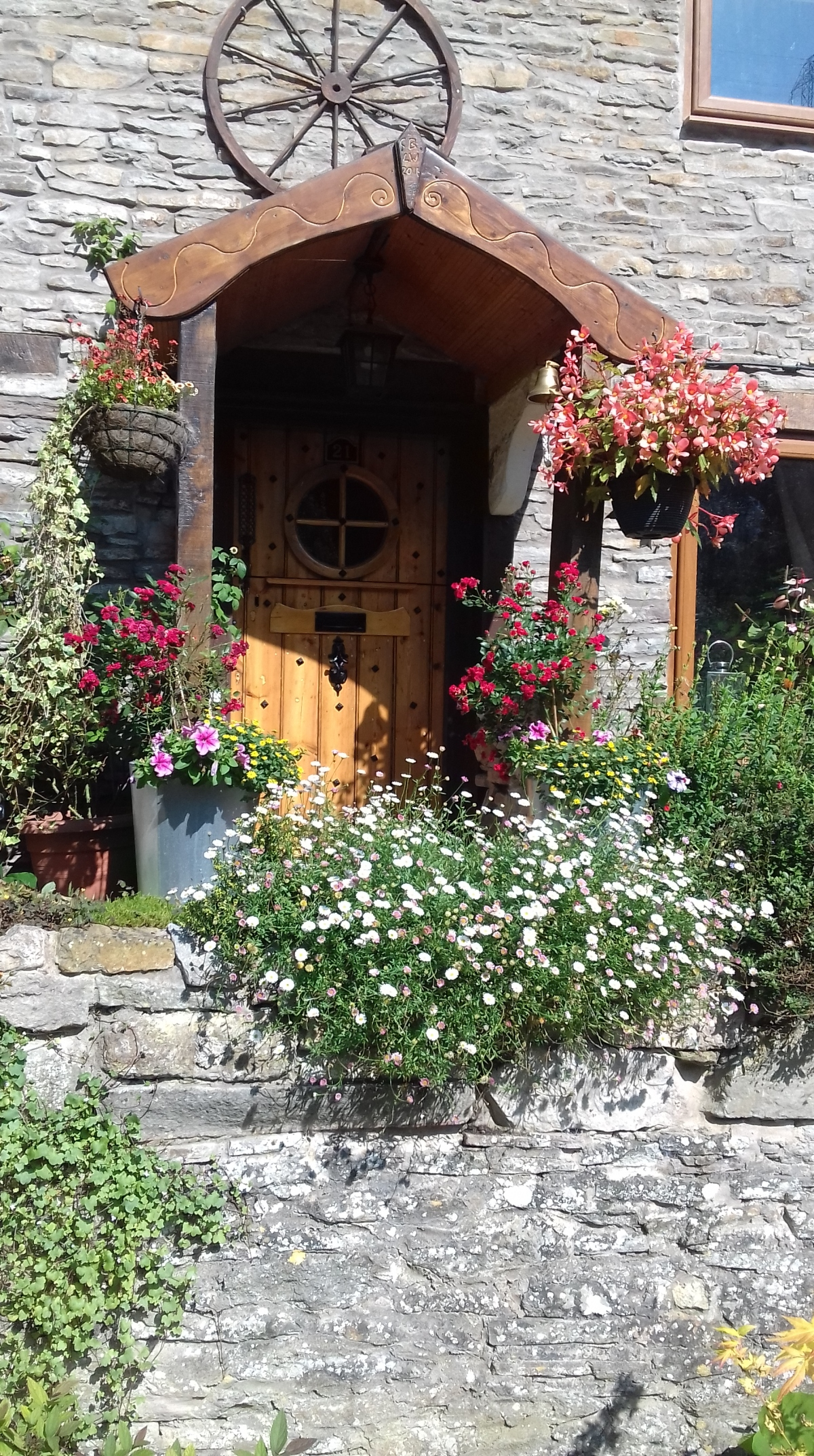 Flowers round the door. Riverside cottage