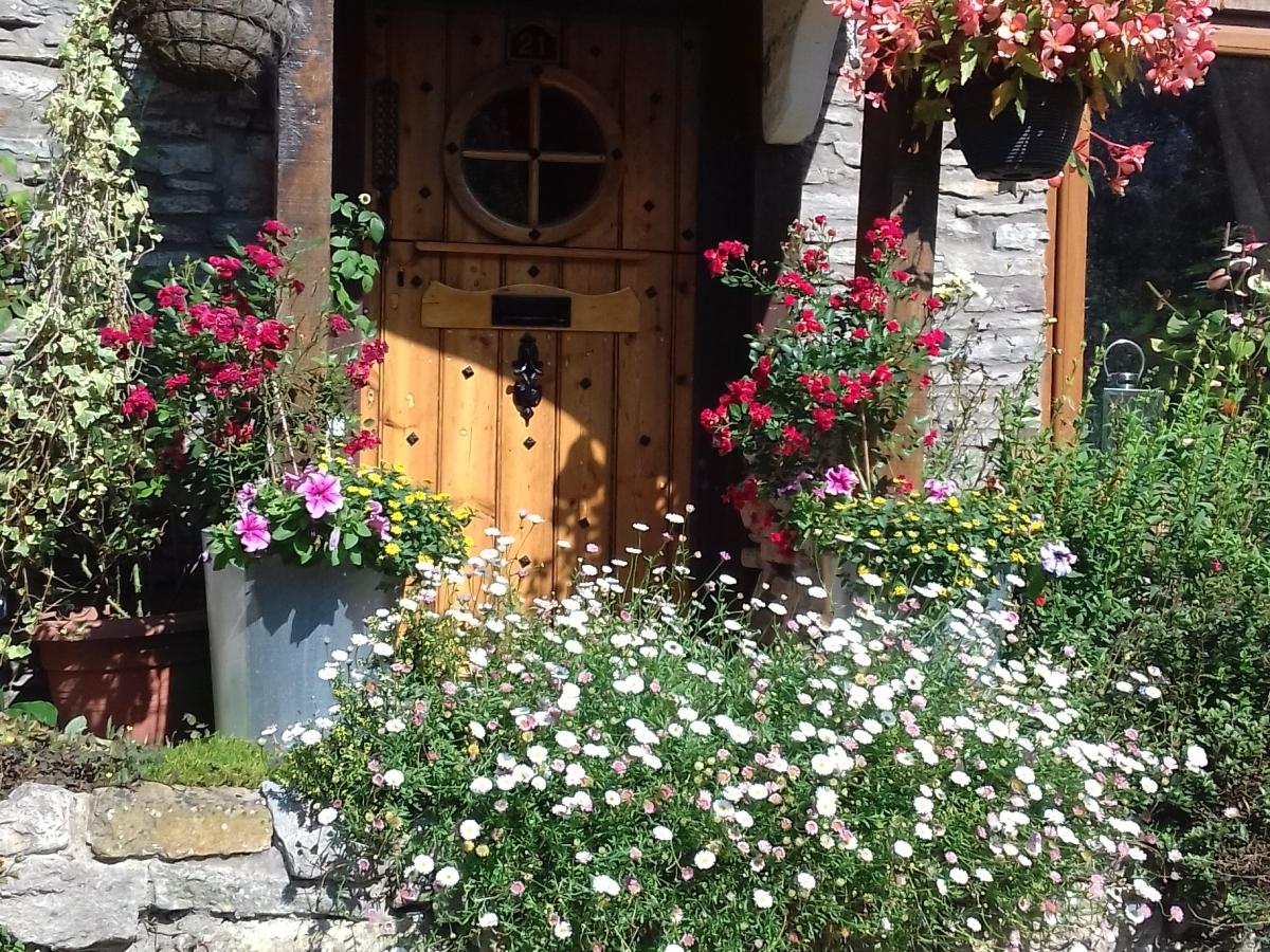 Flowers round the door. Riverside cottage
