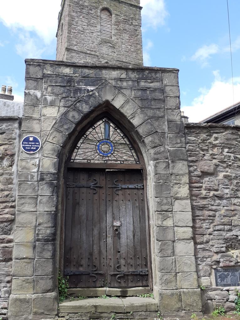 The wooden door of the old grammar school