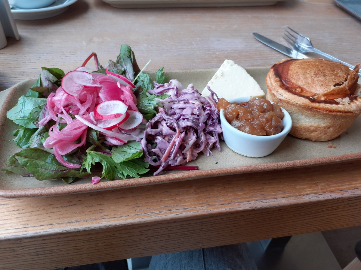 Ploughman's lunch with Wensleydale cheese, pork pie, chutney and coleslaw