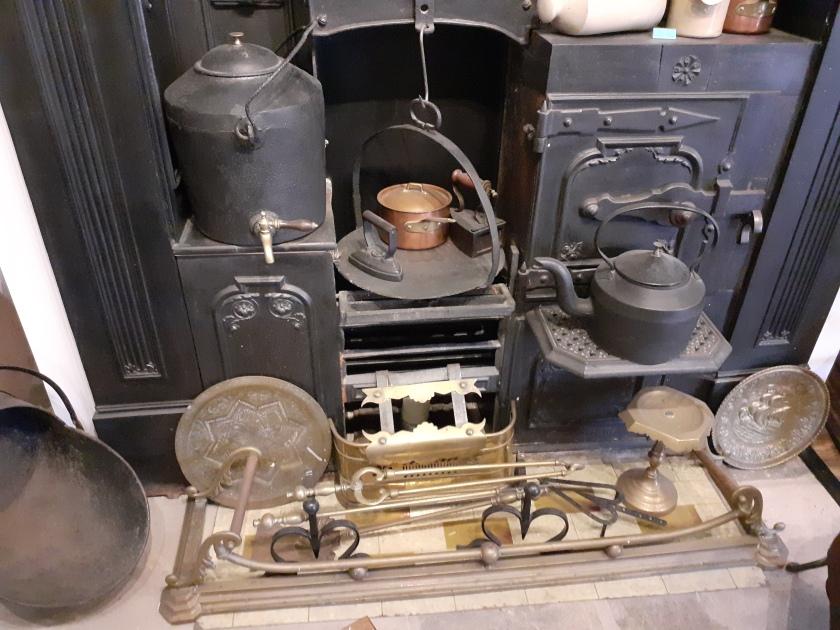 A farmhouse Kitchen complete with cast iron range.